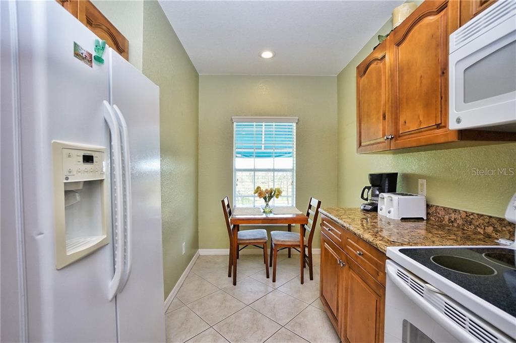 Kitchen showing small dining area  in kitchen - Condo for sale at 8405 Placida Rd #401, Placida, FL 33946 - MLS Number is C7414726