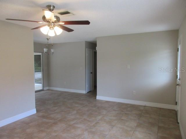 FROM LIVING ROOM FAR CORNER LOOKING TOWARDS DINING AREA, HALLWAY TO RIGHT TO BEDROOMS - Single Family Home for sale at 925 Tropical Ave Nw, Port Charlotte, FL 33948 - MLS Number is C7417107