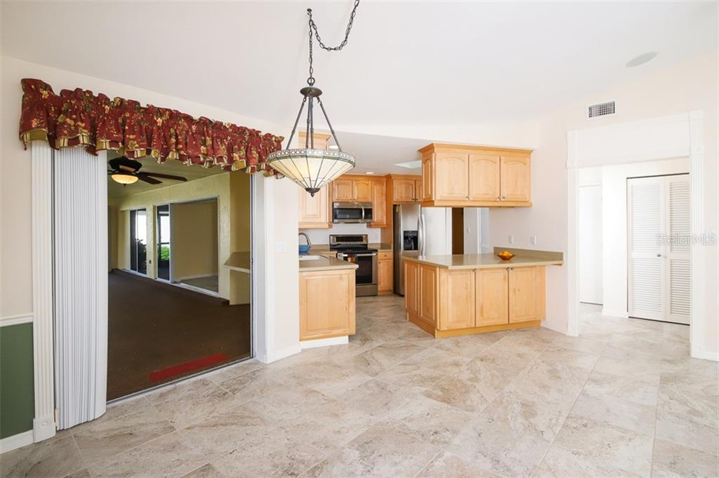 Kitchen feature new stainless appliances & Corian counter tops. Pass-thru window to Lanai - Single Family Home for sale at 2713 Saint Thomas Dr, Punta Gorda, FL 33950 - MLS Number is C7417491