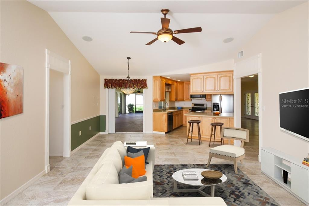Kitchen/ Dinette towards Lanai - Single Family Home for sale at 2713 Saint Thomas Dr, Punta Gorda, FL 33950 - MLS Number is C7417491