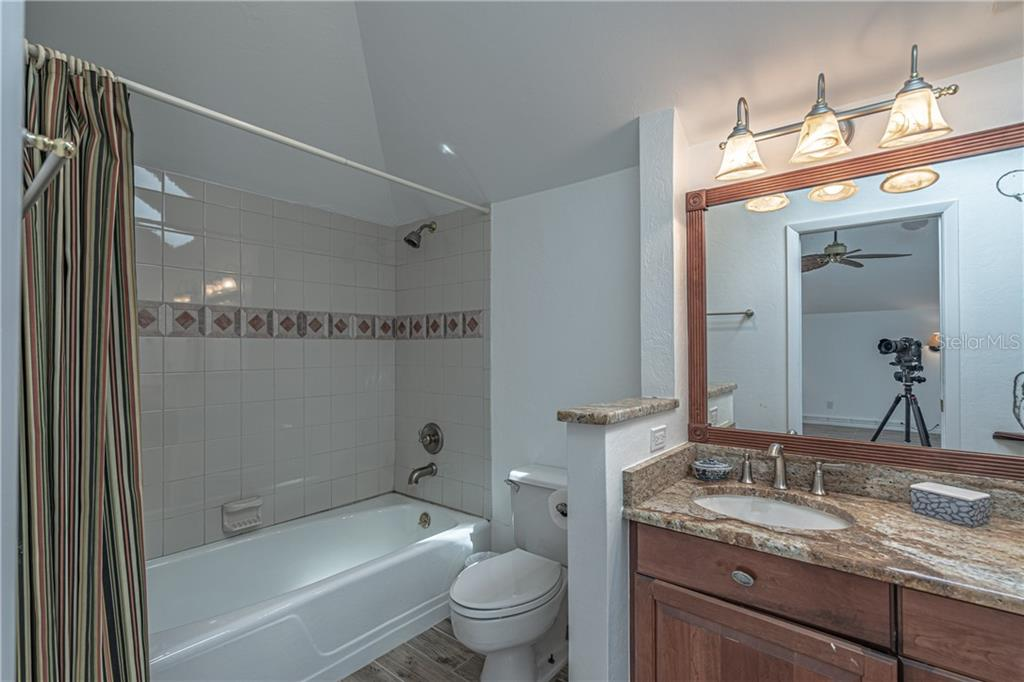 Upper Master #1 ensuite with shower tub - Single Family Home for sale at 124 Useppa Is, Captiva, FL 33924 - MLS Number is C7419408