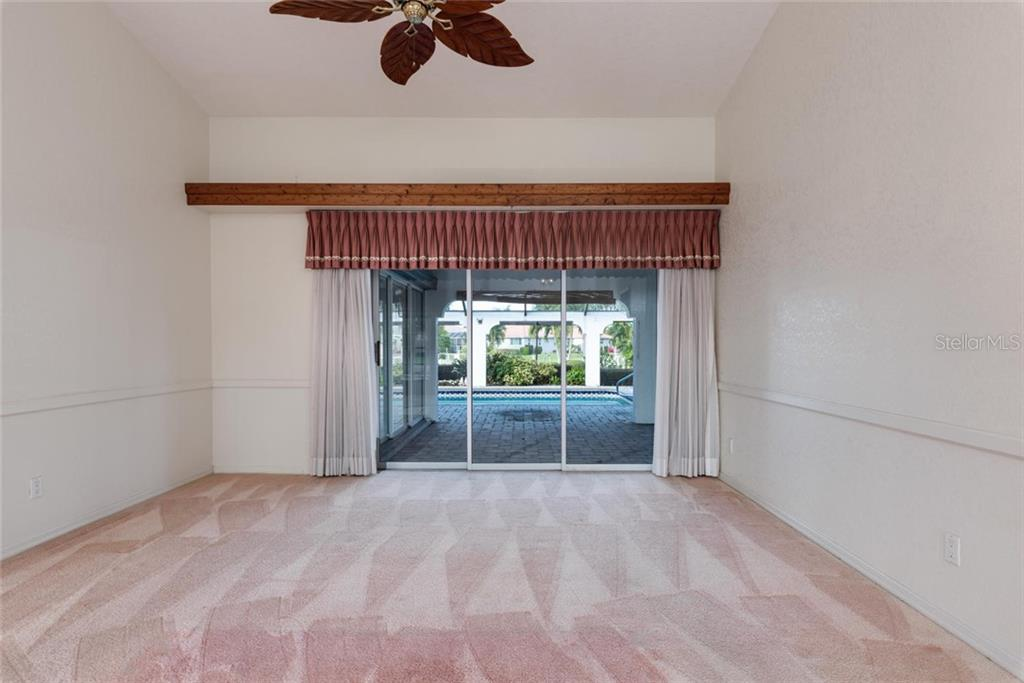 Living room with beautiful view of the pool and canal - Single Family Home for sale at 5001 Captiva Ct, Punta Gorda, FL 33950 - MLS Number is C7422558