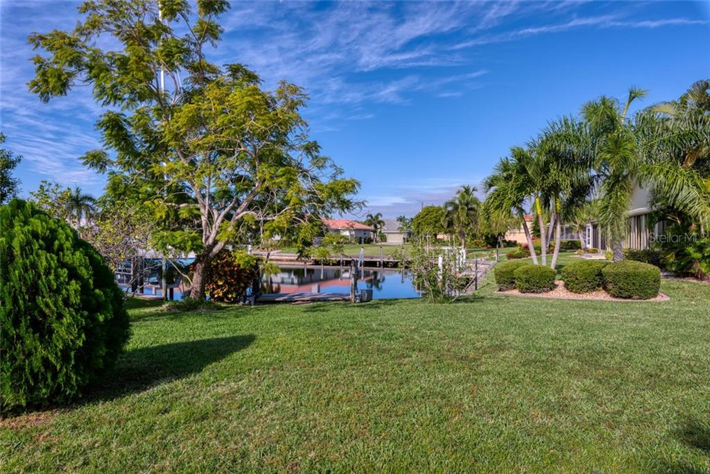 Backyard of home - Single Family Home for sale at 5001 Captiva Ct, Punta Gorda, FL 33950 - MLS Number is C7422558