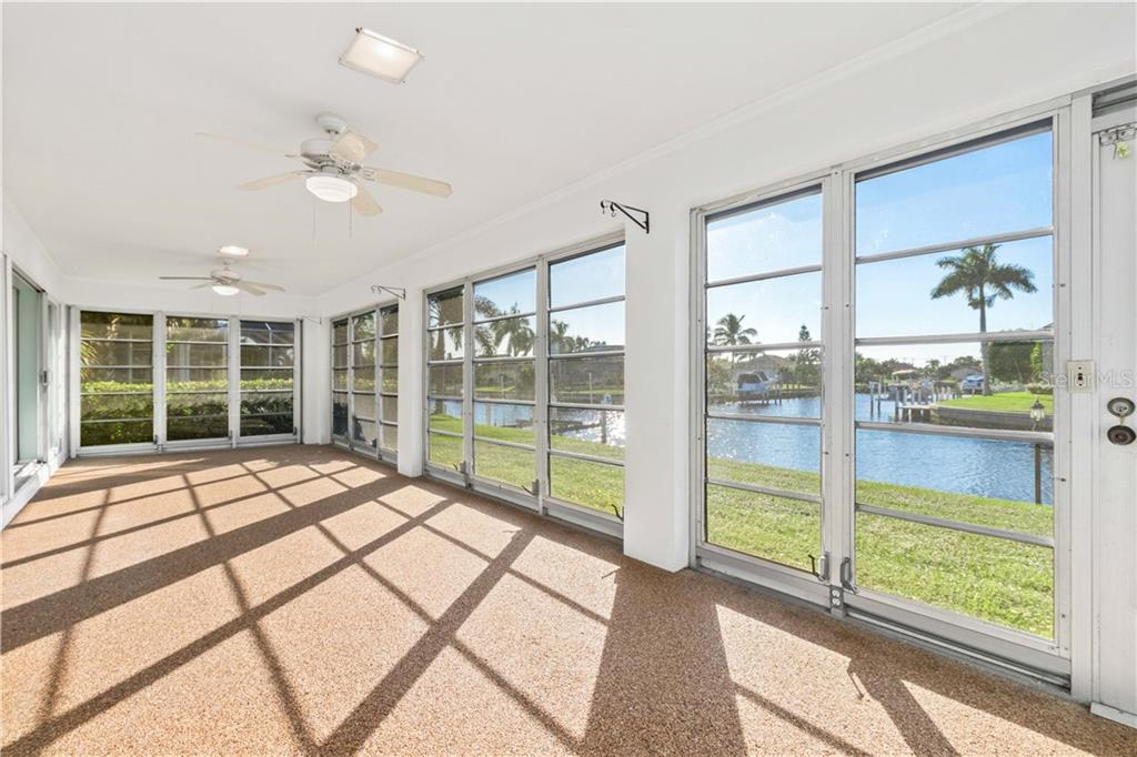 Water front Florida Room - Single Family Home for sale at 415 Caicos Dr, Punta Gorda, FL 33950 - MLS Number is C7422767