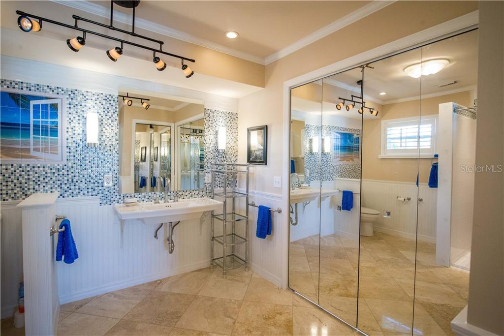 Beautiful tile surrounds this updated bath with new roll-in shower.  Huge walk-in closet with ample storage. - Single Family Home for sale at 1440 Appian Dr, Punta Gorda, FL 33950 - MLS Number is C7425399