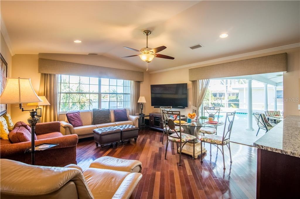 A cozy great room is strategically positioned off your gormet kitchen and accesses the oversized lanai through pocketed, hidden sliders. - Single Family Home for sale at 1440 Appian Dr, Punta Gorda, FL 33950 - MLS Number is C7425399