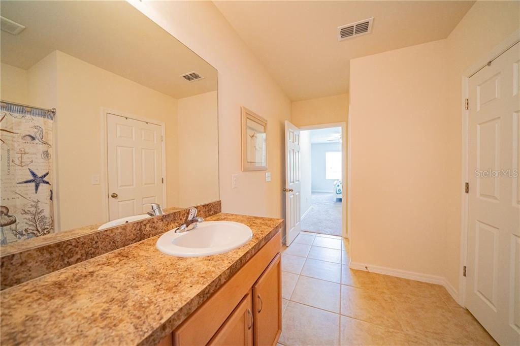 Ensite Owner bath has two closets. - Single Family Home for sale at 25041 Lalique Pl, Punta Gorda, FL 33950 - MLS Number is C7430423