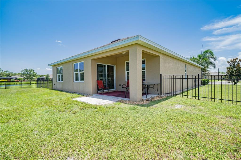 Rear & left side - Single Family Home for sale at 25041 Lalique Pl, Punta Gorda, FL 33950 - MLS Number is C7430423