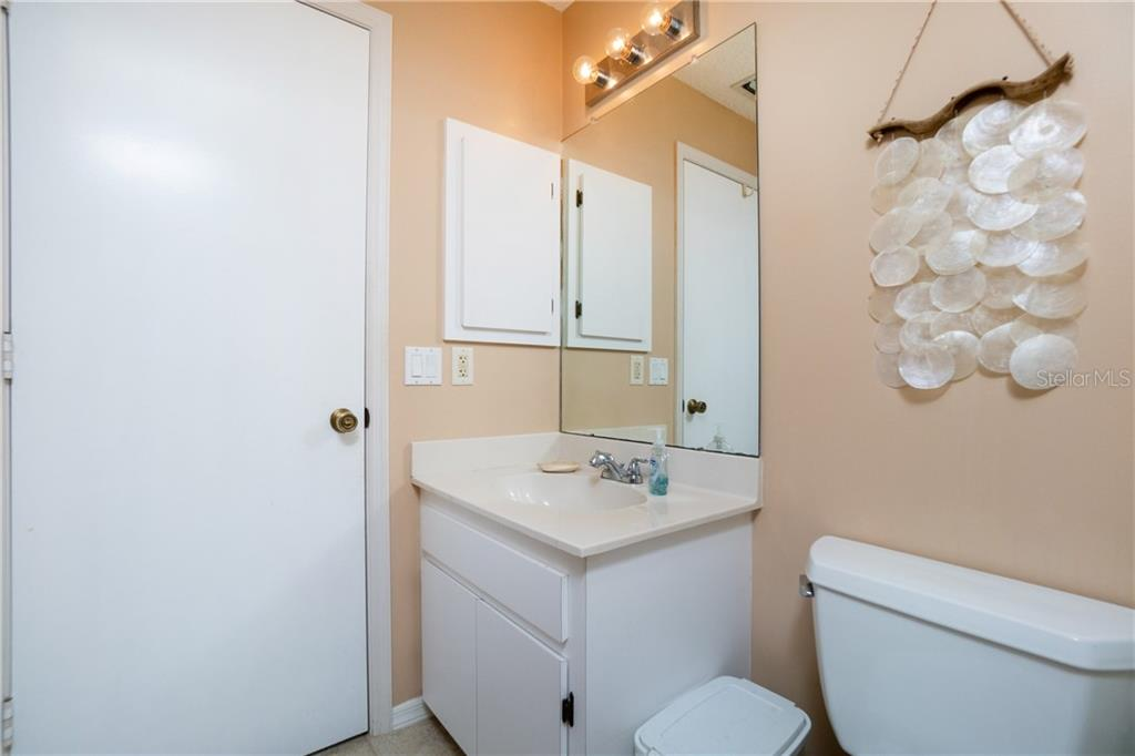 Hall bath vanity - Single Family Home for sale at 23374 Macdougall Ave, Port Charlotte, FL 33980 - MLS Number is C7430508