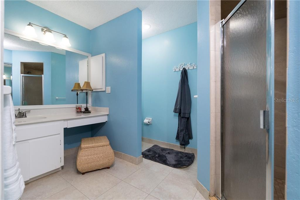 Owners' bath features potty alcove & corner tiled shower. - Single Family Home for sale at 23374 Macdougall Ave, Port Charlotte, FL 33980 - MLS Number is C7430508