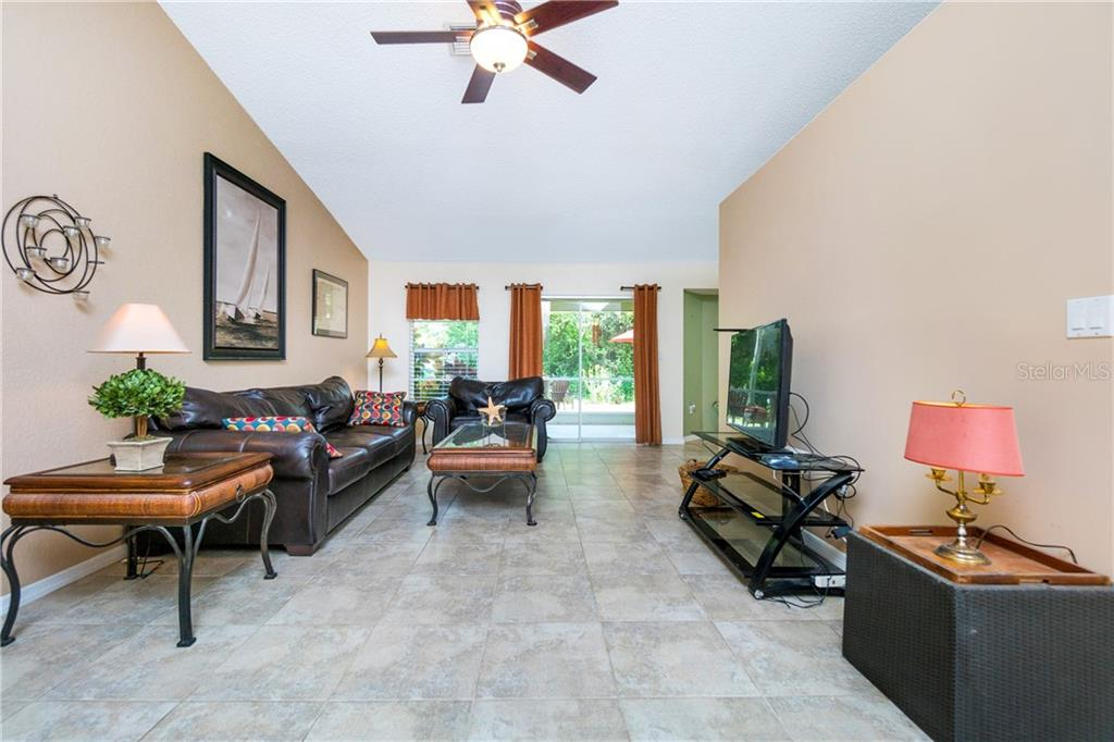 View of the Great Room upon entry with vista to great backyard. - Single Family Home for sale at 23374 Macdougall Ave, Port Charlotte, FL 33980 - MLS Number is C7430508