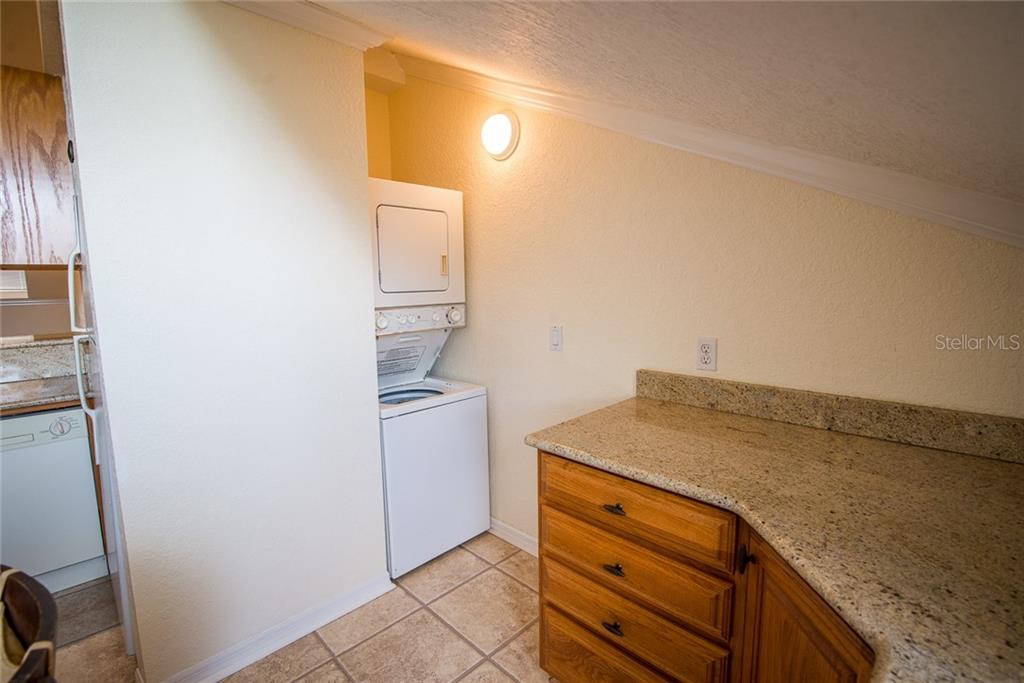 Stackable washer and dryer provides convenience. - Condo for sale at 4410 Warren Ave #511, Port Charlotte, FL 33953 - MLS Number is C7432222