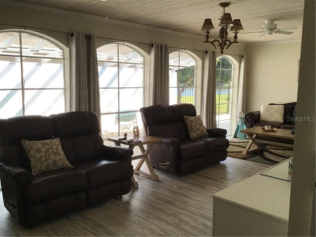 Family Room.     Courtyard in Windows - Single Family Home for sale at 1302 Pinebrook Way, Venice, FL 34285 - MLS Number is C7435367