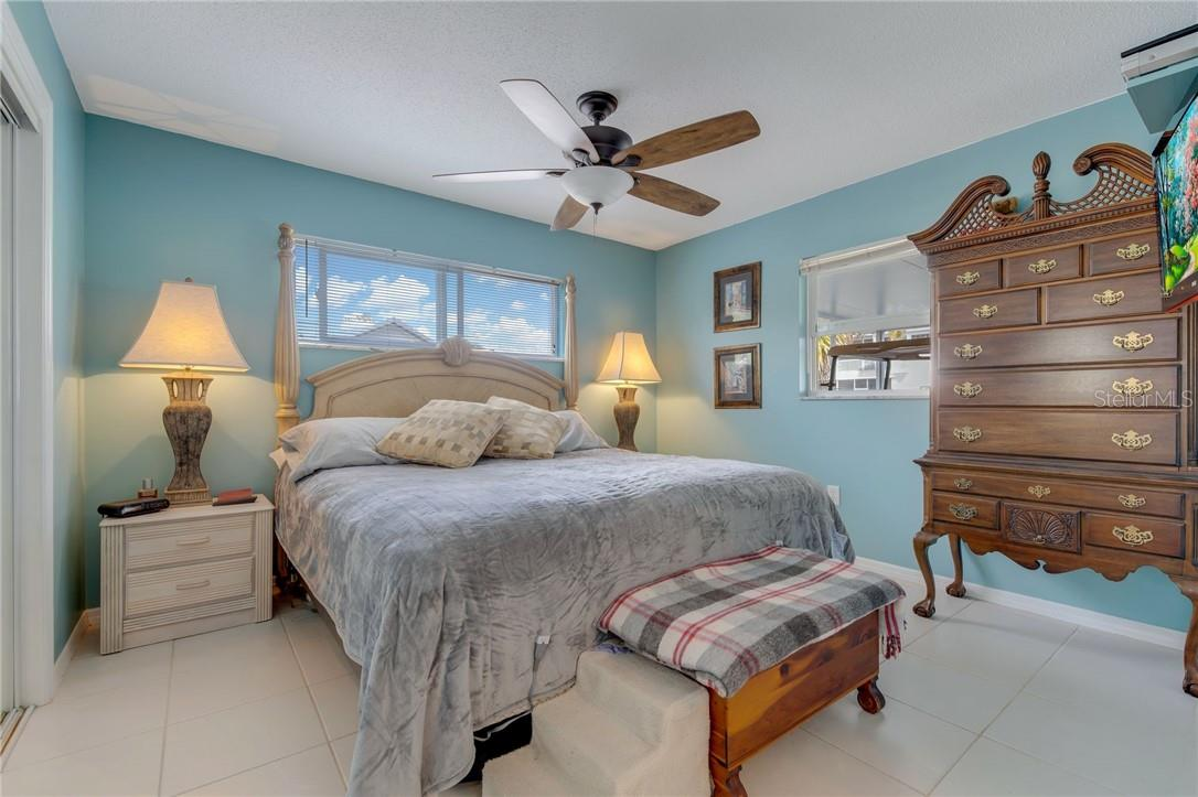 Large owners bedroom with abundant windows to bring in the sunshine. - Single Family Home for sale at 24368 Blackbeard Blvd, Punta Gorda, FL 33955 - MLS Number is C7436898