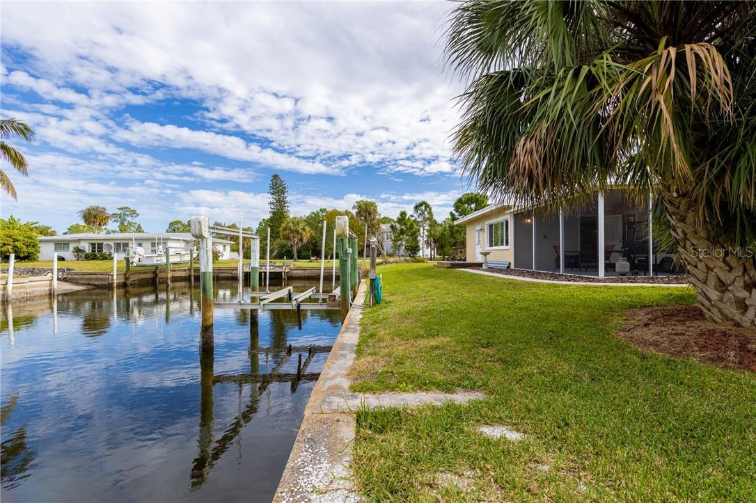 103' concrete seawall with a 9,500lb boat lift, this comfortable home is ready for waterfront fun - Single Family Home for sale at 24368 Blackbeard Blvd, Punta Gorda, FL 33955 - MLS Number is C7436898