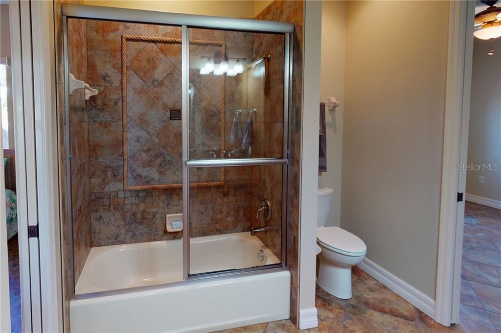 1st floor guest bath. - Single Family Home for sale at 4245 Spire St, Port Charlotte, FL 33981 - MLS Number is C7437570
