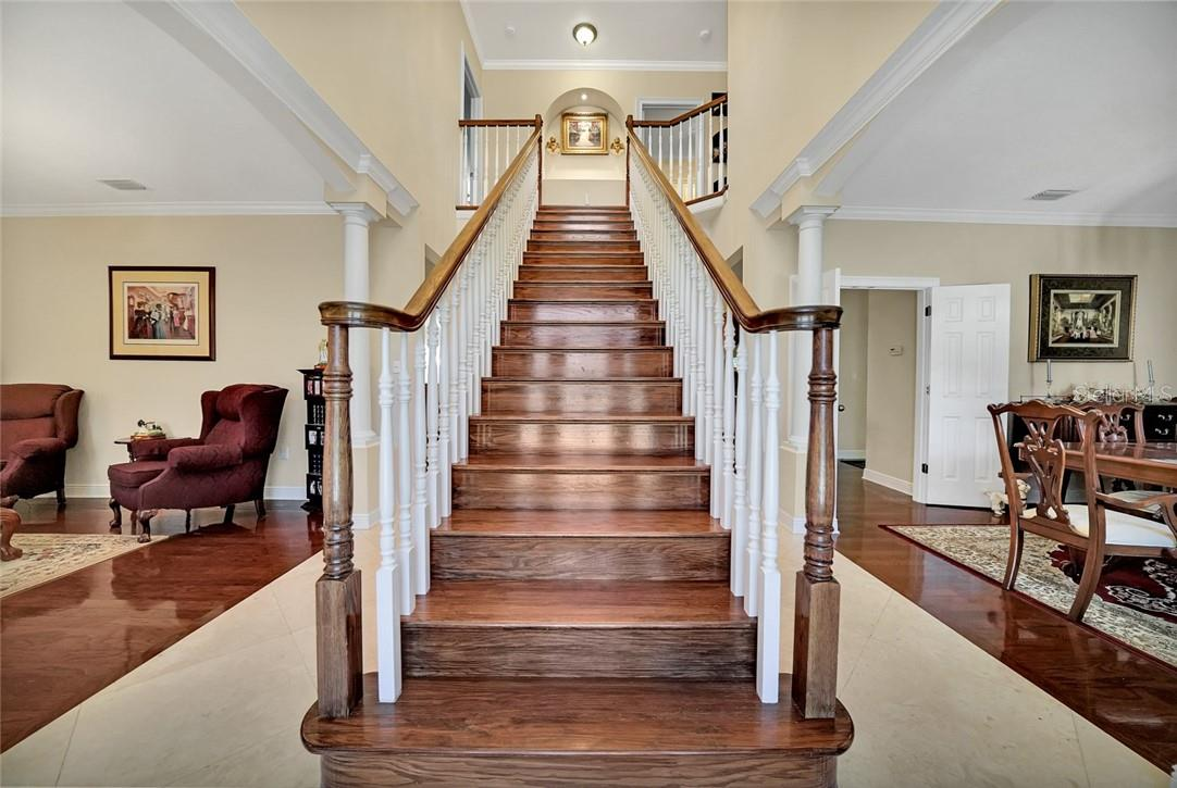 Grand staircase upon entry, marble tile foyer - Single Family Home for sale at 10230 Sw County Road 769, Arcadia, FL 34269 - MLS Number is C7437596