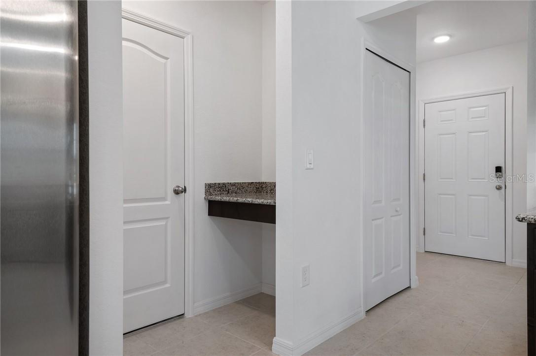 Door into the garage has a drop area for those who can never locate their keys!!! - Single Family Home for sale at 2082 Apian Way, Port Charlotte, FL 33953 - MLS Number is C7441465