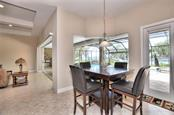 Kitchen dining area with aquarium windows and door beaming with an abundance of natural light! - Single Family Home for sale at 2839 Mill Creek Rd, Port Charlotte, FL 33953 - MLS Number is C7238545