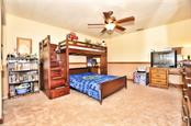 Guest Bedroom #3 - Single Family Home for sale at 30720 Washington Loop Rd, Punta Gorda, FL 33982 - MLS Number is C7239690