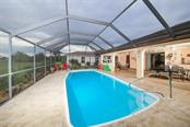 Enjoy swimming in this fabulous solar heated pool - Single Family Home for sale at 26178 Rampart Blvd, Punta Gorda, FL 33983 - MLS Number is C7240559