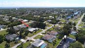 Located less than 10 minutes to the Port Charlotte Beach with tennis courts, pool and public boat ramp - and less than 15 minutes to downtown Punta Gorda, this is truly your dream home! - Single Family Home for sale at 4407 Albacore Cir, Port Charlotte, FL 33948 - MLS Number is C7245070