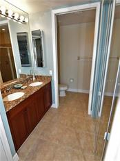 Master bath with dual sinks, walk-in closet and shower - Condo for sale at 1340 Rock Dove Ct #124, Punta Gorda, FL 33950 - MLS Number is C7411764