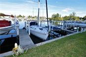 Deeded boat slip (#5) with water and electrical service - Condo for sale at 1340 Rock Dove Ct #124, Punta Gorda, FL 33950 - MLS Number is C7411764