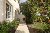 Side entrance to condo is simply enchanting - Condo for sale at 4643 Club Dr #102, Port Charlotte, FL 33953 - MLS Number is C7413207