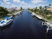 Looking down Blue Lagoon canal from lot to harbor. - Vacant Land for sale at 53 Tropicana Dr, Punta Gorda, FL 33950 - MLS Number is C7420346