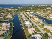 Aerial showing proximity to Peace River & 41 bridges - Single Family Home for sale at 415 Caicos Dr, Punta Gorda, FL 33950 - MLS Number is C7422767