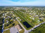 Single Family Home for sale at 24082 Harborview Rd, Port Charlotte, FL 33980 - MLS Number is C7423143