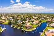 LARGE TIP LOT WITH BIG WATER VIEWS - Single Family Home for sale at 3537 Caya Largo Ct, Punta Gorda, FL 33950 - MLS Number is C7431664