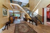 Inside and out, from top to bottom. Natural light fills the spaces from the moment you enter the double doors into the grand foyer - Single Family Home for sale at 7440 Riverside Dr, Punta Gorda, FL 33982 - MLS Number is C7436263