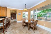 Guests can dine in the generously sized dinette open to the kitchen or the elegant formal dining room for a stately meal - Single Family Home for sale at 7440 Riverside Dr, Punta Gorda, FL 33982 - MLS Number is C7436263