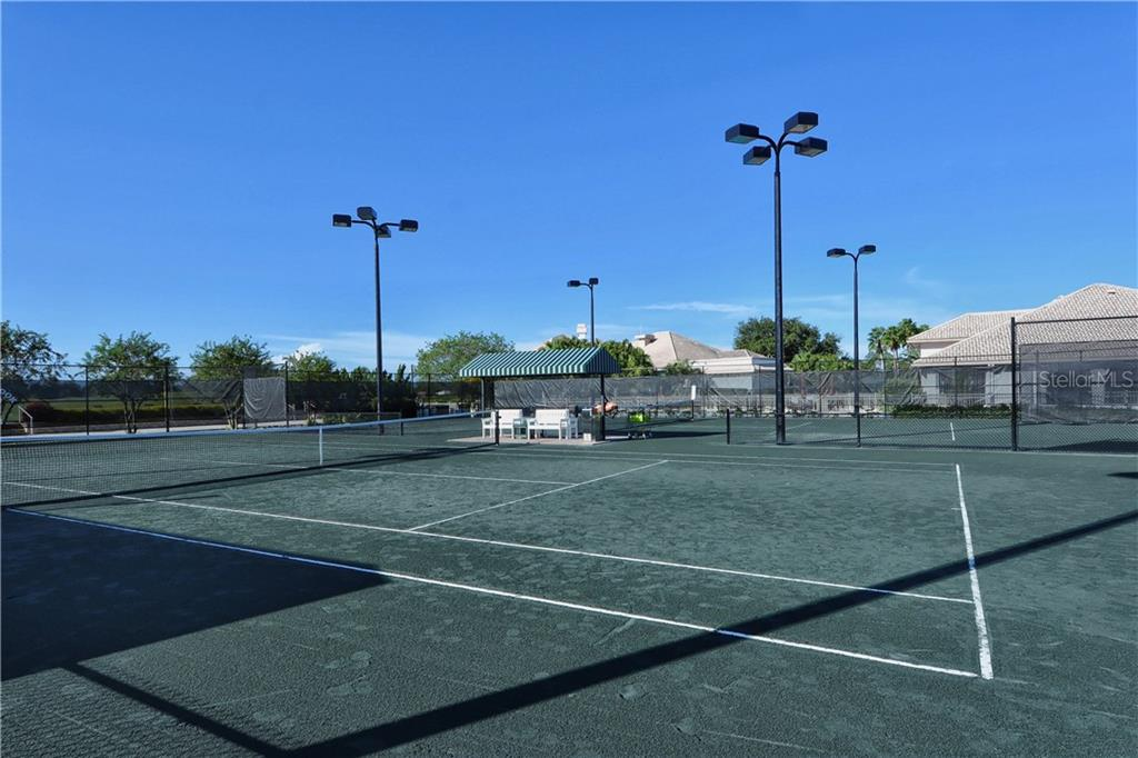 Lighted Har-Tru Tennis courts enhance the club's active tennis activities. - Single Family Home for sale at 8753 Merion Ave, Sarasota, FL 34238 - MLS Number is A4165409