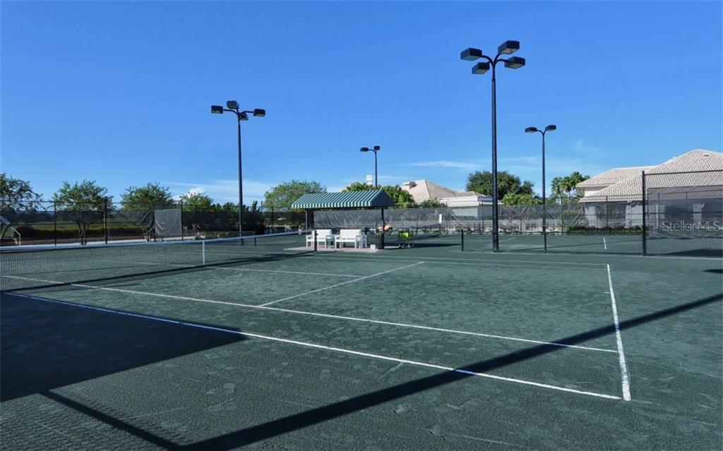 Stoneybrook Golf & Country Club lighted Har-Tru tennis courts. - Condo for sale at 9630 Club South Cir #6103, Sarasota, FL 34238 - MLS Number is A4166105