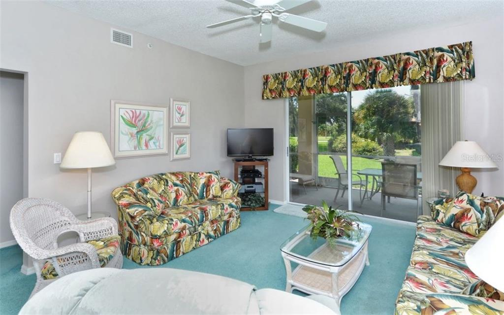 Another view to lanai area and tropical serene setting outside. - Condo for sale at 9630 Club South Cir #6103, Sarasota, FL 34238 - MLS Number is A4166105