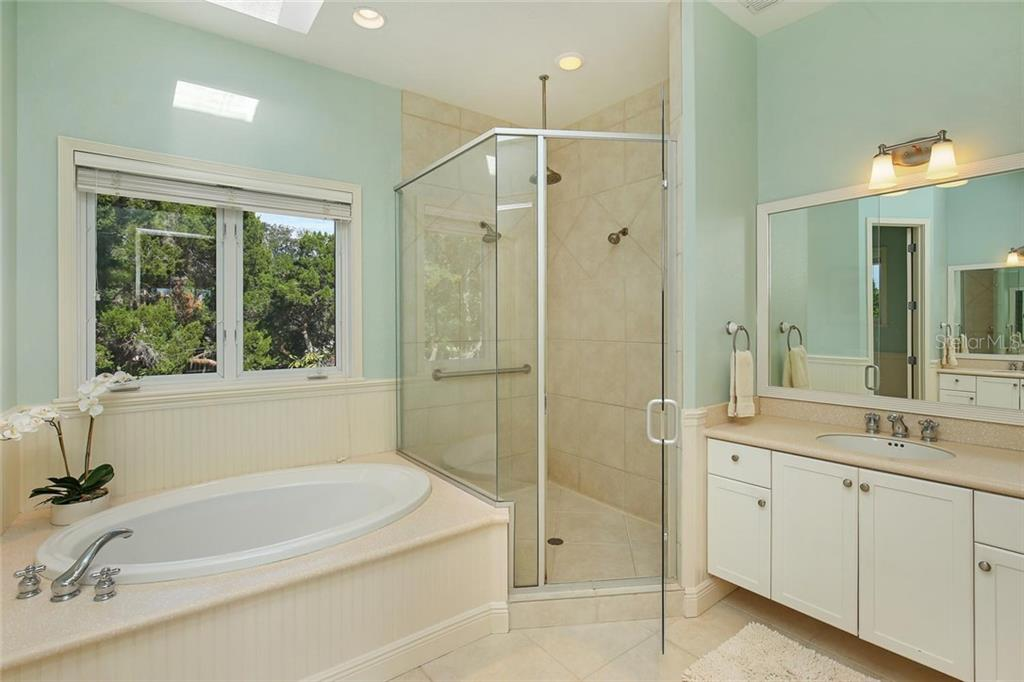 Master Bath - dual vanities, Sky Light, Bead Board & Garden Style Soaking Tub! - Single Family Home for sale at 722 Siesta Dr, Sarasota, FL 34242 - MLS Number is A4169257