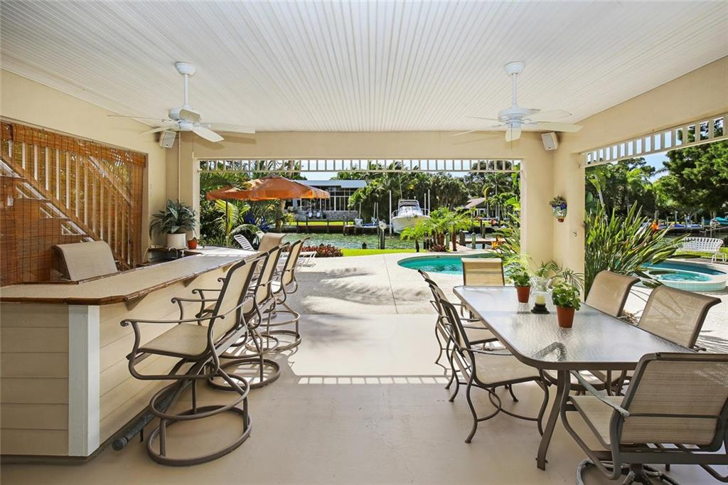 Ground Floor provides great outdoor entertaining space walking out from indoor entertaining space! - Single Family Home for sale at 722 Siesta Dr, Sarasota, FL 34242 - MLS Number is A4169257