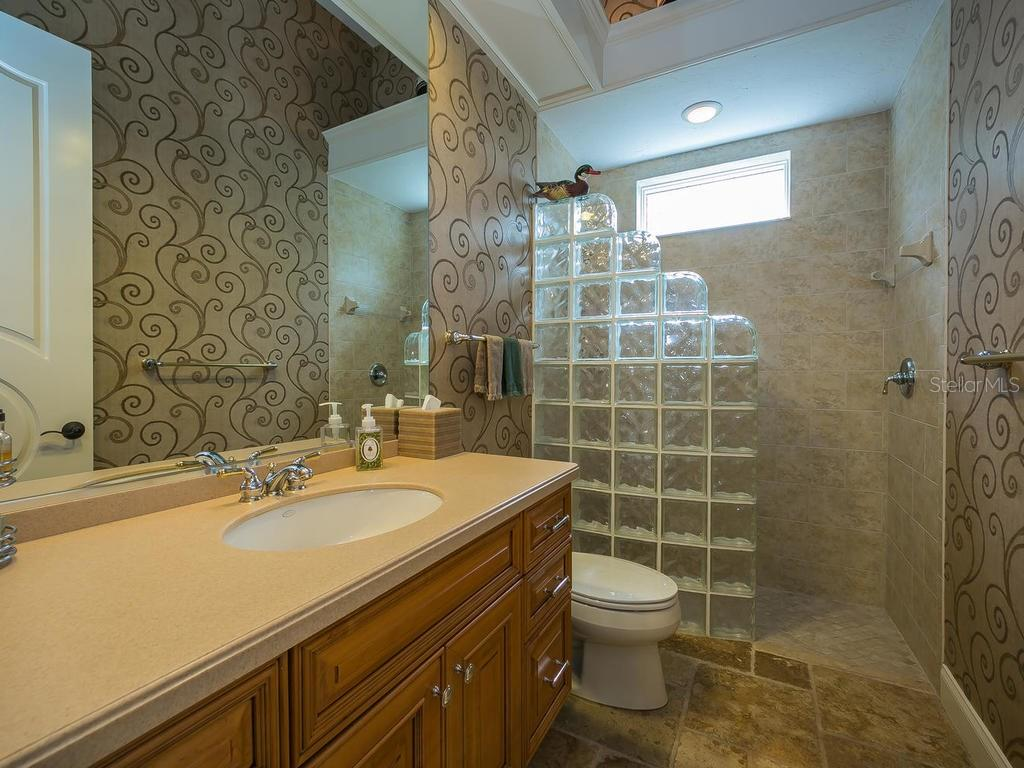 All bedrooms are ensuite.  This is one of the secondary bathrooms. - Single Family Home for sale at 3313 Founders Club Dr, Sarasota, FL 34240 - MLS Number is A4169443