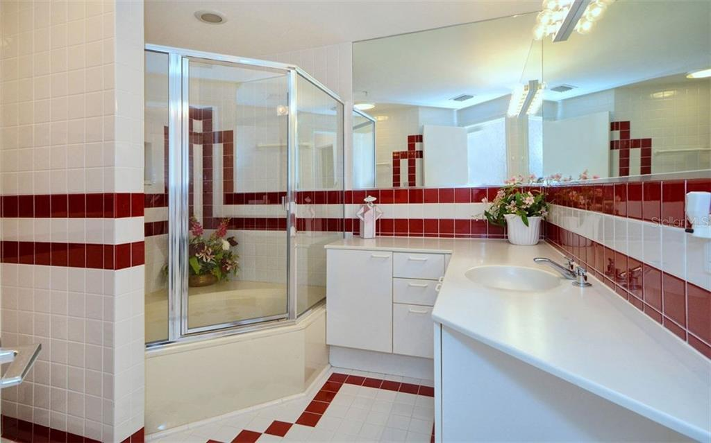 Guest Bathroom - Single Family Home for sale at 535 Sanctuary Dr #c108, Longboat Key, FL 34228 - MLS Number is A4172623