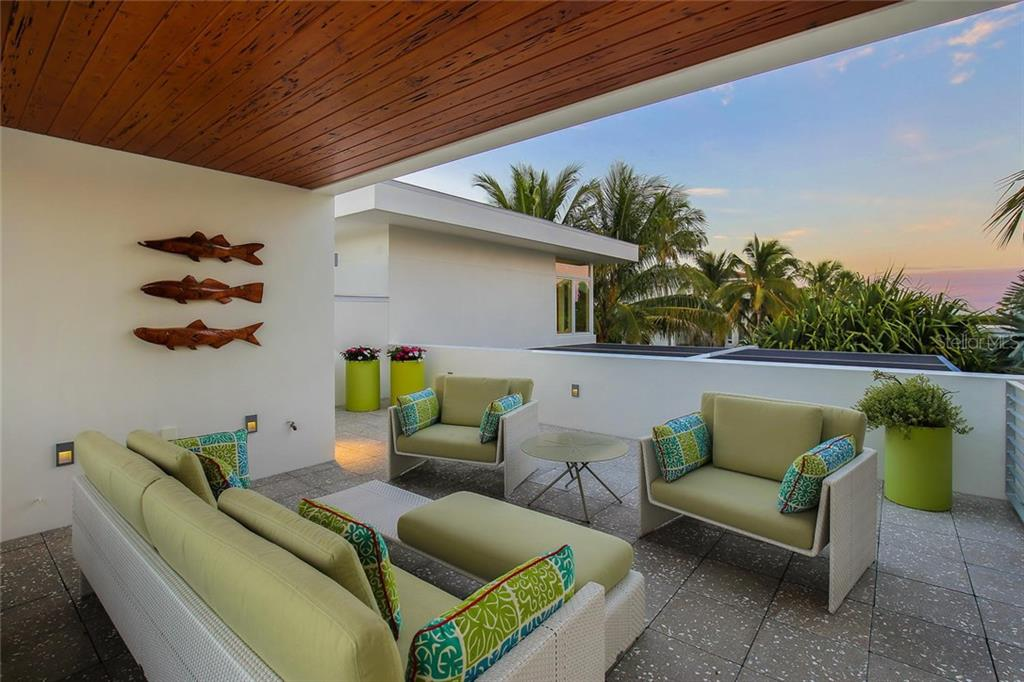 Upper open sun deck with gorgeous sunset views, LED landscape lighting and outdoor speakers. - Single Family Home for sale at 593 Rountree Dr, Longboat Key, FL 34228 - MLS Number is A4172941
