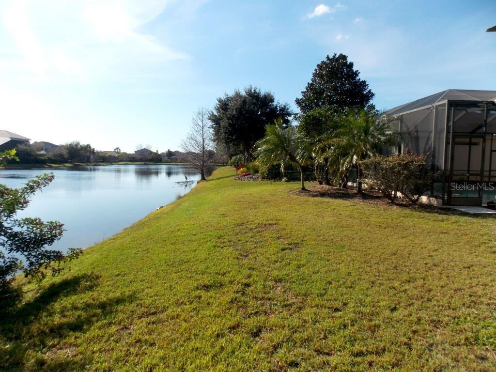 Backyard view down the lake. - Single Family Home for sale at 13470 Purple Finch Cir, Lakewood Ranch, FL 34202 - MLS Number is A4173216