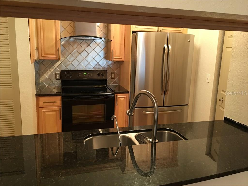 Stainless Steel appliances. New Kitchen lighting. Light and bright. Breakfast bar. - Condo for sale at 1064 N Tamiami Trl #1131, Sarasota, FL 34236 - MLS Number is A4174927