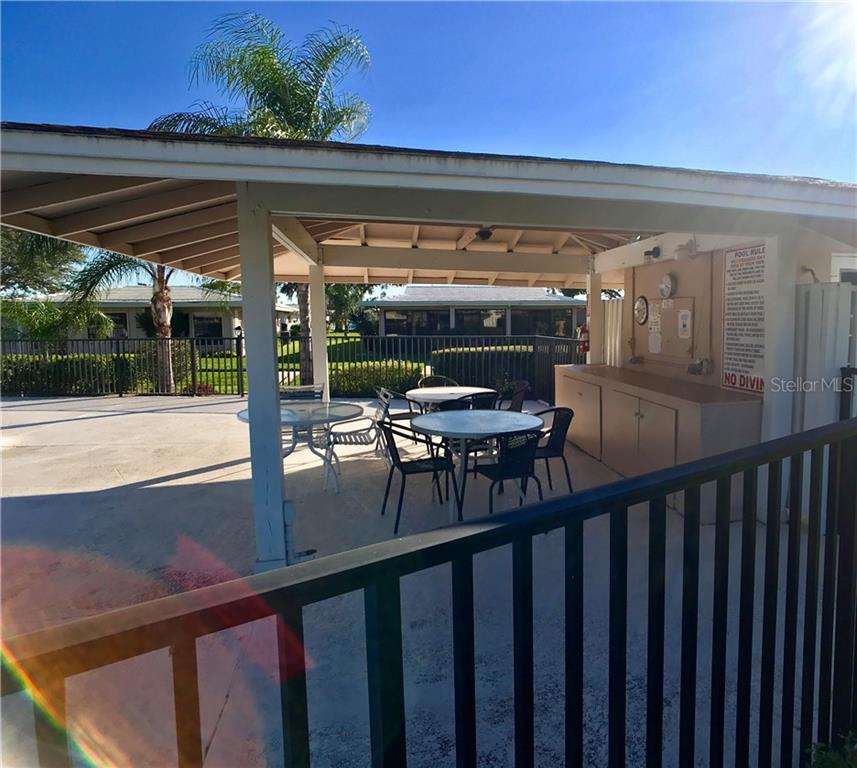 Covered pool area - Villa for sale at 3230 Brunswick Ln #709, Sarasota, FL 34239 - MLS Number is A4175978