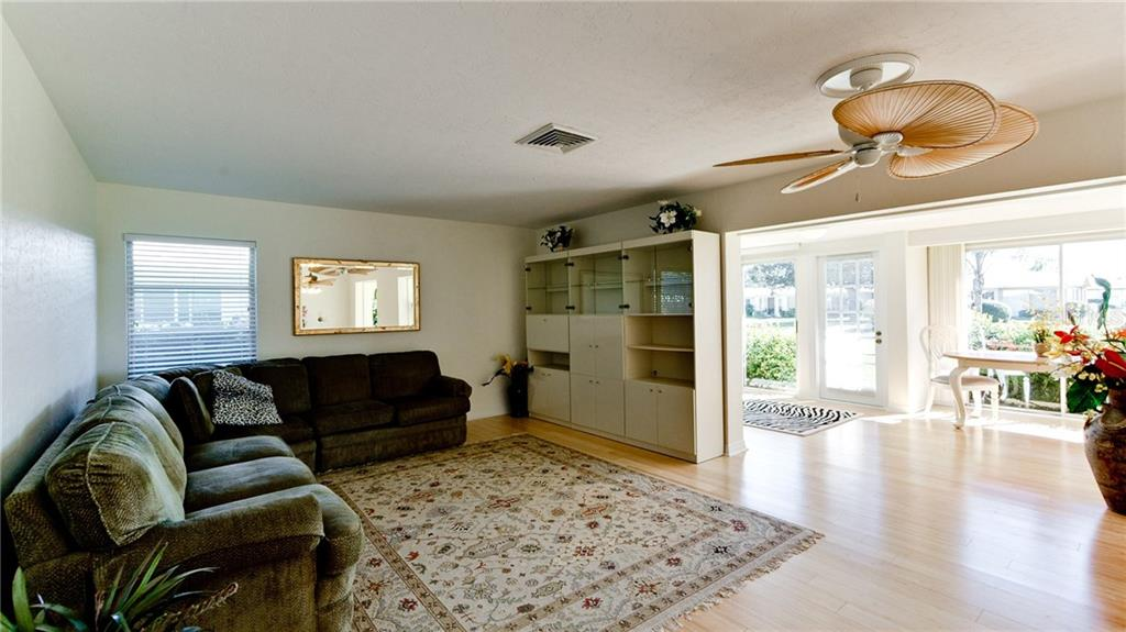 living room and sunroom - Villa for sale at 3230 Brunswick Ln #709, Sarasota, FL 34239 - MLS Number is A4175978