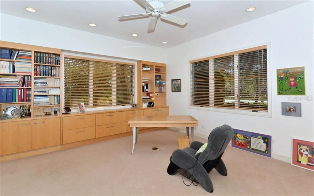 Large Office/Multi Purpose Room - includes another wall of Built In Shelves/Cabinets - Single Family Home for sale at 3111 Dick Wilson Dr, Sarasota, FL 34240 - MLS Number is A4176685