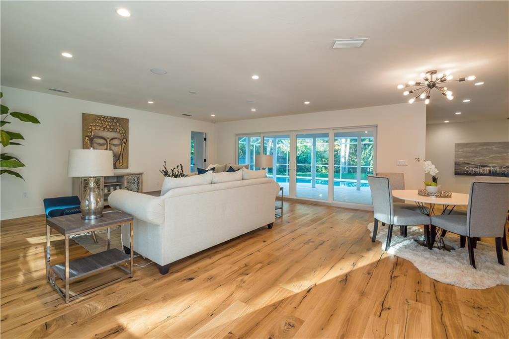 French oak flooring throughout entire home, all new led lighting. - Single Family Home for sale at 5115 Dewey Pl, Sarasota, FL 34242 - MLS Number is A4177178