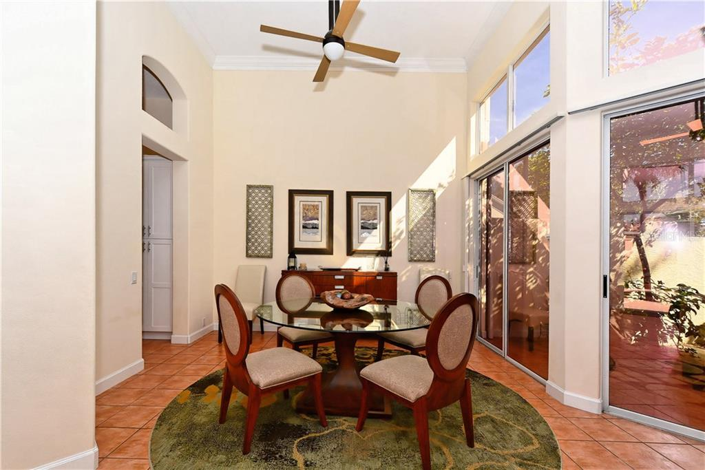 Dining Room looking into rear courtyard - Single Family Home for sale at 602 Weston Pointe Ct, Longboat Key, FL 34228 - MLS Number is A4178531